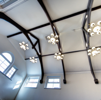 The main boardroom boasts a stunning vaulted ceiling